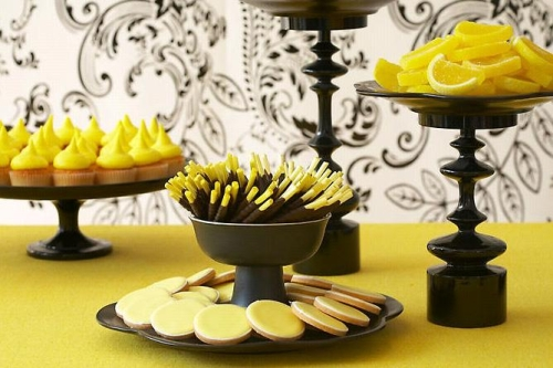 Here custom yellow and black chocolates licorice mints and lemon cupcakes