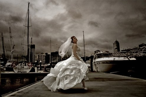 A professional wedding photographer with postproduction image processing