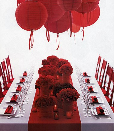 This red and white wedding reception table on the other hand