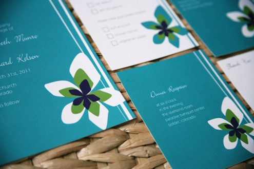 This beautiful teal wedding invitation suite with its threetone flower