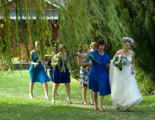 mother-of-the-bride walks down the aisle