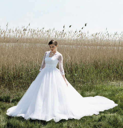 Blanche de Boh me is a crossovereffect bustier wedding dress in lace tulle