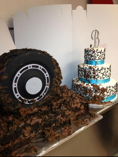 Grooms cake shaped like tire in chocolate mud.
