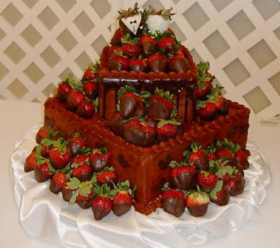 This fabu wedding cake is surrounded by yummy chocolate covered strawberries